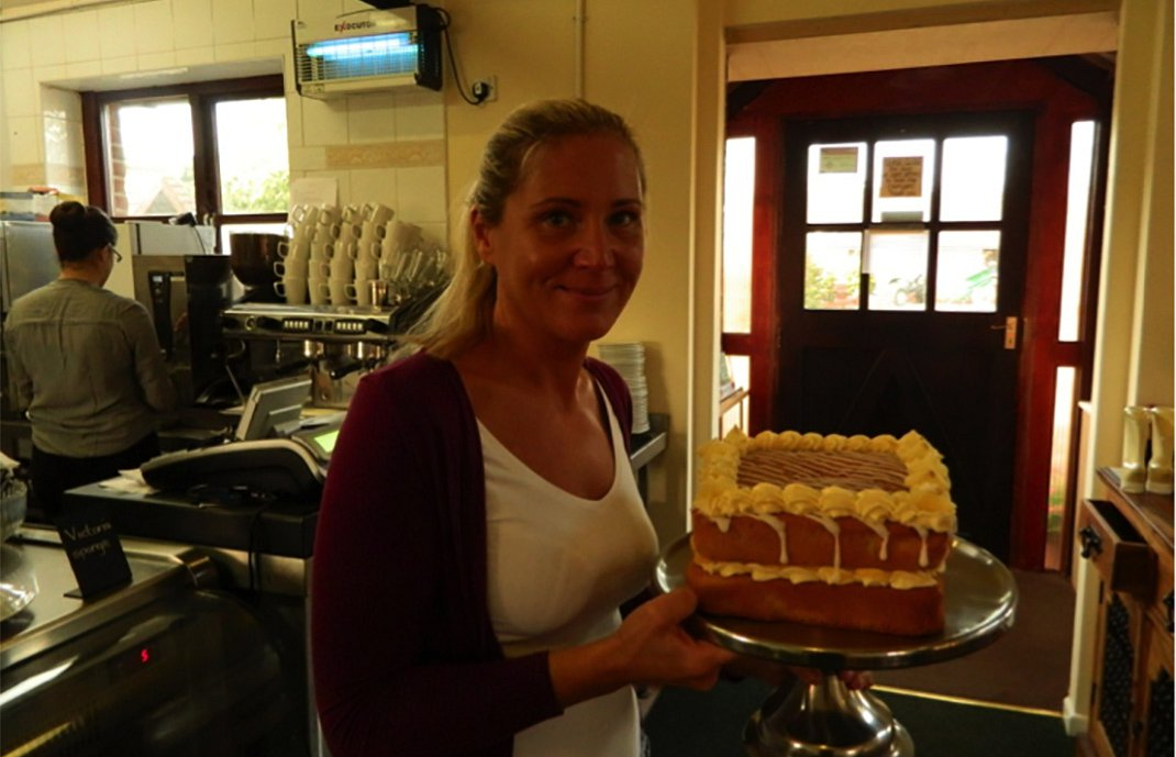 Sue and one of her delicious cakes!